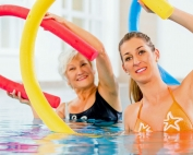 Fibromyalgia Treatment: Aquatic vs Land Aerobic and Stretching Exercises